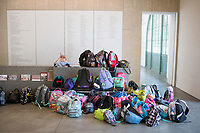School bags at the Museum of Contemporary Art San Diego (MCA SD) San Diego California. Crossing the border from Tijuana, Mexico to San Diego, USA.