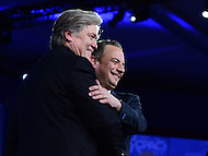 National Harbor, MD - February 23, 2017: White House Chief of Staff Reince Priebus and Steve Bannon, president Trump's chief , greet each other before speaking to attendees of the Conservative Political Action Conference at the Gaylord Hotel in National Harbor, MD, February 23, 2017, during a forum moderated by Matt Schlapp, Chairman of the American Conservative Union.  (Photo by Don Baxter/Media Images International)