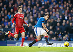 Lee Wallace through on goal but pulls his shot wide