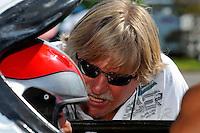 F1 (boat) World Champion talks with driver Ahmad Al Hameli during testing..Bay City River Roar, Bay City,Michigan USA.26-2821 June, 2009..©F. Peirce Williams 2009 USA.F.Peirce Williams.photography.ref: RAW (.NEF) File Available