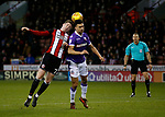 John Lundstram of Sheffield Utd challenges Antonee Robinson of Bolton Wanderers during the Championship match at Bramall Lane Stadium, Sheffield. Picture date 30th December 2017. Picture credit should read: Simon Bellis/Sportimage