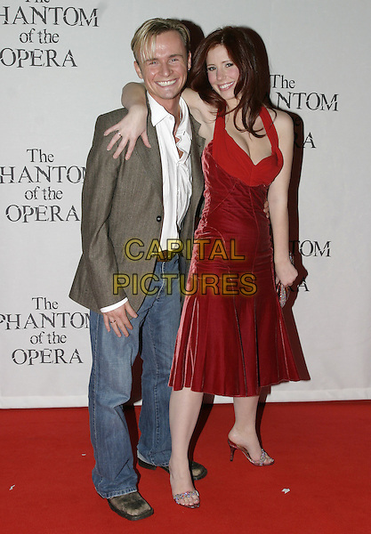 """JOHN (S CLUB 7) & AMY NUTTALL .""""The Phantom of the Opera"""" World Premiere Party,.Grand Hall Olympia, London, December 6th 2004..full length red dress hugging jon.Ref: AH.www.capitalpictures.com.sales@capitalpictures.com.©Capital Pictures."""