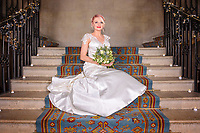 Relaxed pose of Bride on staircase at Ashridge House
