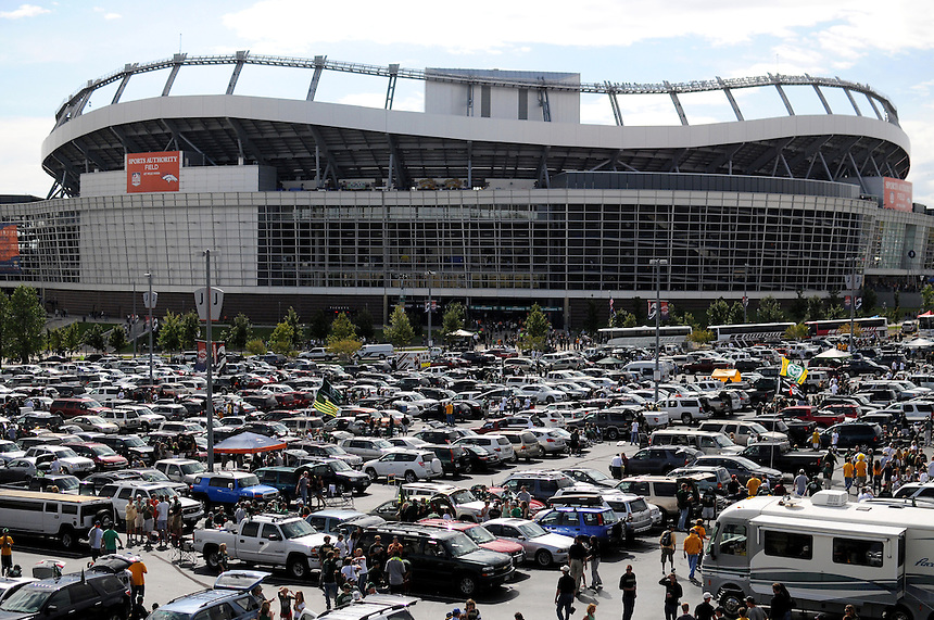 SEPTEMBER 17, 2011:    Colorado Buffaloes fans tailgate and party outside of Sports Authority Field at Mile High in this general view outside the stadium during an inter-conference game between the Colorado State Rams and the University of Colorado Buffaloes at Sports Authority Field at Mile High Field in Denver, Colorado. The Buffaloes led 14-7 at halftime*****For editorial use only*****