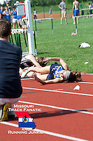 Seckman senior Katelyn Evans lands on the track after stumbling across the finish line, while Rockwood Summit freshman Melissa Menghini sits on the track and appears to stretch across the finish line. The pair made a furious dash to the finish in the Class 4 Sectional 1 800 meters, both fighting for the fourth and final qualifying spot for the State Track and Field Championships. Evans earned 4th place with an offiicial time of 2:22.70, while Menghini was clocked crossing the finish line at 2:24.32