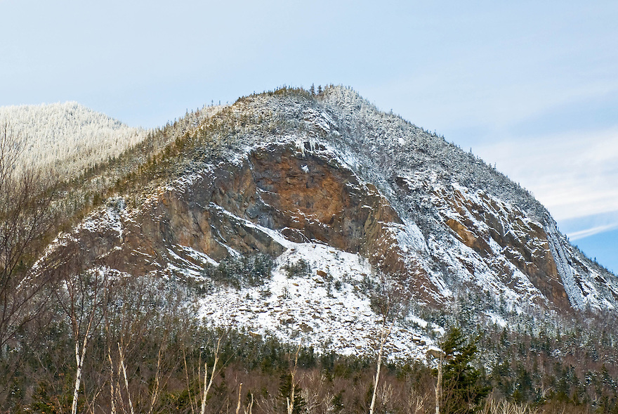 "Fresh snow adorns the ""Painted Cliff"" on the East Peak of Mt Osceola, Waterville Valley, New Hampshire."