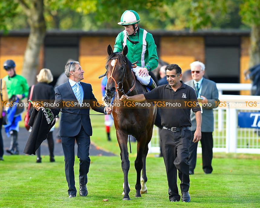 Winner of The PKF Francis Clark EBF Novice Stakes Div 1   Kaloor ridden by Jim Crowley and trained by Brian Meehan is led into the winners enclosure during Afternoon Racing at Salisbury Racecourse on 3rd October 2018