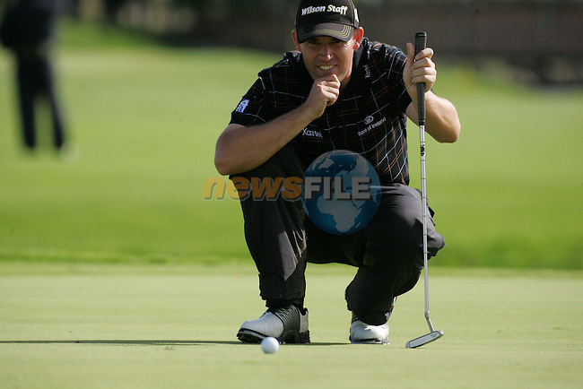 Padraig Harrington lines up his putt on the par 3 17th hole during the first round of the Smurfit Kappa European Open at The K Club, Strffan,Co.Kildare, Ireland 5th July 2007 (Photo by Eoin Clarke/NEWSFILE)