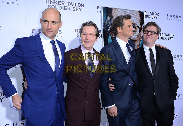 Mark Strong, Gary Oldman, Colin Firth, and Tomas Alfredson.The premiere of Focus Features' 'Tinker, Tailor, Soldier, Spy' held at Arclight Cinema's Cinerama Dome, Los Angeles, California, USA..December 6th, 2011.half length blue white blue tie brown maroon burgundy jacket suit purple shirt glasses profile  .CAP/ADM/TW.©Tonya Wise/AdMedia/Capital Pictures.