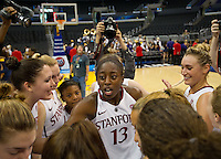 LOS ANGELES, CA - March 10, 2012: Stanford forward Chiney Ogwumike (13) celebrates with teammates their victory against Cal during the PAC 12 Woman's Basketball Championship Game at the Staples Center in Los Angeles California. Final score Stanford won 77-62.