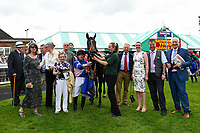 Connections of Simply Breathless in the winners enclosure after winning The Bathwick Tyres Novice Auction Stakes(plus 10, Div 2), during Afternoon Racing at Salisbury Racecourse on 13th June 2017