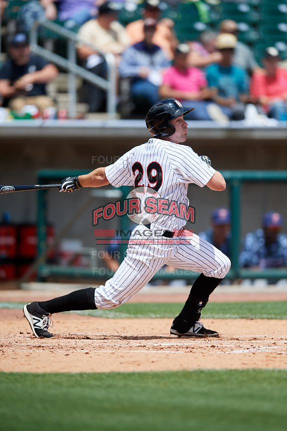 Birmingham Barons center fielder Hunter Jones (29) follows through on a swing during a game against the Jacksonville Jumbo Shrimp on April 24, 2017 at Regions Field in Birmingham, Alabama.  Jacksonville defeated Birmingham 4-1.  (Mike Janes/Four Seam Images)