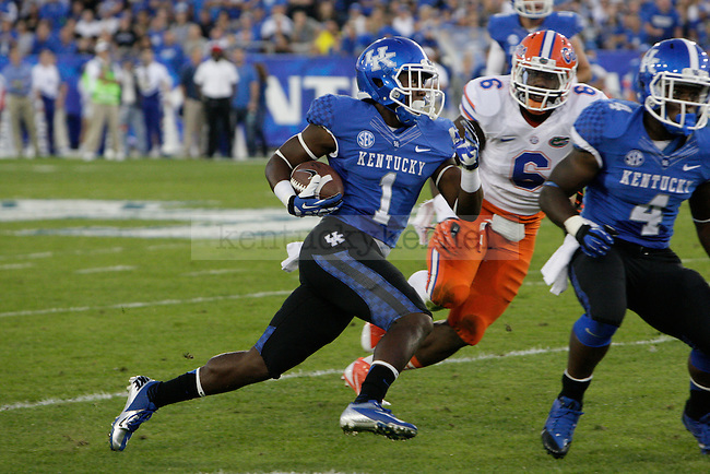 Kentucky Wildcats running back Ryan Timmons (1) makes a big run during the first half of the UK Football game against Florida at Commonwealth Stadium in Lexington, Ky., on Saturday, September, 28, 2013. Photo by Jonathan Krueger | Staff