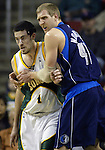 Dallas Mavericks' Dirk Nowitzki (R) blocks Seattle SuperSonics' Nick Collison out of the play in the first period of their game at the Key Arena in Seattle, Washington Wednesday, 13 April  2005.. Jim Bryant Photo. ©2010. All Rights Reserved.