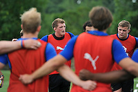Bath Rugby captain Stuart Hooper speaks to his players in a huddle. Bath Rugby training session on August 4, 2015 at Farleigh House in Bath, England. Photo by: Patrick Khachfe / Onside Images