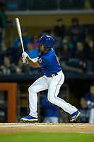 Kean Wong (5) of the Durham Bulls follows through on his swing against the Gwinnett Braves at Durham Bulls Athletic Park on April 20, 2019 in Durham, North Carolina. The Bulls defeated the Braves 3-2 in game two of a double-header. (Brian Westerholt/Four Seam Images)