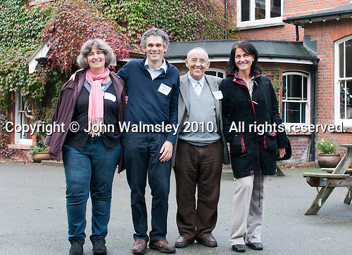 """Group of Hungarian visitors to Summerhill School, Suffolk, England October 2010.  l to r: Maria Honty, Peter Foti, Tamas Vekerdy and Csilla Mihalisc.  They came to see and learn, in the hope that liberal education can have a comeback in Hungary.  Maria Honty is a psychologist.  Peter Foti is a writer on education.  Tamas Vekerdy, a psychologist, writes books about children, leader of the Department dealing with alternative education, main revitaliser of the Waldorf Movement in Hungary after 1989 and wrote the preface to the Hungarian edition of A.S.Neill's book in 2004.  Csilla Mihalisc is a journalist from """"Nok Lapja"""", the biggest women's weekly magazine in Hungary. The school was founded by A.S.Neill in 1921 and is run on democratic lines with each person, adult or child, having an equal say.  You don't have to go to lessons if you don't want to but could play all day.  It gets above average GCSE exam results."""