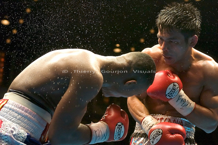 Terdsak Jandaeng (r) lands a right hand flush against Joan Guzman during their WBO Featherweight Eliminator Fight at the Westchester County Center, White Plains, NY on 08.26.2005..Guzman won by unanimous decision.