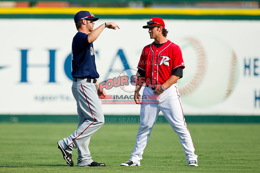 Bryce Harper #34 of the Harrisburg Senators chats with Charlie Culberson #6 of the Richmond Flying Squirrels prior to game one of a double-header at The Diamond on July 22, 2011 in Richmond, Virginia.  The Squirrels defeated the Senators 3-1.   (Brian Westerholt / Four Seam Images)