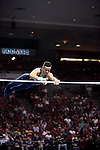 20 APR 2012: Paul Ruggeri of the University of Illinois competes in the H Bar competition during the Division I Men's Gymnastics Championship held at the Lloyd Noble Center on the University of Oklahoma campus in Norman, OK. The University of Illinois finished in first place with a score of 358.85. Stephen Pingry/NCAA Photos