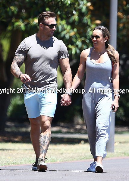 27 JANUARY 2014 SYDNEY AUSTRALIA<br /> <br /> EXCLUSIVE<br /> <br /> Michelle Bridges &amp; Commando Steve pictured taking their dog for a walk at Glebe Park<br /> <br /> *No internet without clearance*<br /> MUST CALL PRIOR TO USE .<br /> +61 2 9211-1088<br /> Matrix Media Group<br /> Note: All editorial images subject to the following: For editorial use only. Additional clearance required for commercial, wireless, internet or promotional use.Images may not be altered or modified. Matrix Media Group makes no representations or warranties regarding names, trademarks or logos appearing in the images.