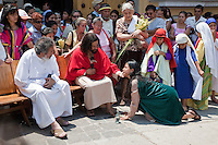 Jesus Blesses the Woman who Washes his Feet with her Tears, Dries them with her Hair.  (Luke 7: 36-50).  Palm Sunday Re-enactment of events in the life of Jesus, by the group called Luna LLena (Full Moon), a group of volunteers in Antigua, Guatemala.