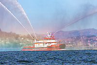 San Francisco Fireboat 3 leads the Parade of Ships with a spray of water at the start of the 2016 San Francisco Fleet Week activities.