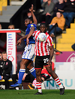 Lincoln City's John Akinde vies for possession with Macclesfield Town's Nathan Cameron<br /> <br /> Photographer Chris Vaughan/CameraSport<br /> <br /> The EFL Sky Bet League Two - Lincoln City v Macclesfield Town - Saturday 30th March 2019 - Sincil Bank - Lincoln<br /> <br /> World Copyright © 2019 CameraSport. All rights reserved. 43 Linden Ave. Countesthorpe. Leicester. England. LE8 5PG - Tel: +44 (0) 116 277 4147 - admin@camerasport.com - www.camerasport.com