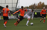 Gavin Gunning (left) and Lee Mair tangle in the St Mirren v Dundee United Clydesdale Bank Scottish Premier League match played at St Mirren Park, Paisley on 27.10.12.