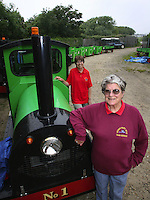 BNPS.co.uk (01202 558833)<br /> Pic: Echo/BNPS<br /> <br /> ***Please use full byline***<br />  <br />  Joyce  Faris , Owner of the Hengistbury Head train service with her daughter  Jill Oliver  at the train's  yard  and garage.<br /> <br /> There was outrage today after a family that has run one of Britain's first 'Noddy' land trains for 46 years were served with a notice to quit the service.<br /> <br /> The much-loved novelty train that carries people to a remote beach was started in 1968 by the late Roger Faris, who hand-built the carriages himself.<br /> <br /> Since his death 34 years ago his widow Joyce, 88, has operated the independent service for 364 days a year and runs it more as a hobby than a profitable business.<br /> <br /> The little train has been used by generations of people and become a popular fixture at the Hengistbury Head beauty spot in Dorset.<br /> <br /> Now after five decades of service, town hall officials have told Mrs Faris they will not be renewing their contract with her as they intend to operate their own train service.