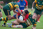 Nigel Watson pulls Jeremiah Fatialofa to ground with help from Dennis Tommy. Counties Manukau Premier Club Rugby game between Ardmore Marist and Pukekohe, played at Bruce Pulman Park Papakura, on April 16th 2011..Ardmore Marist won 23 - 16 after leading 23 - 6 at halftime.