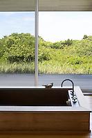 wooden bathtub with garden view