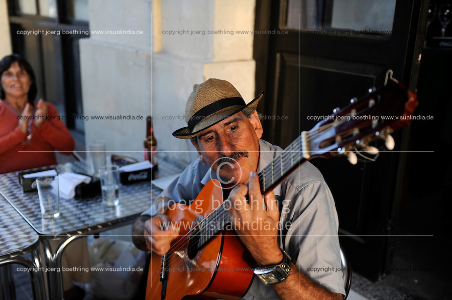 URUGUAY Montevideo, guitar player at pub at port