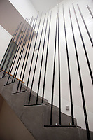"The banisters of the staircase are made from long ""stems"" of steel cut to varying lengths"