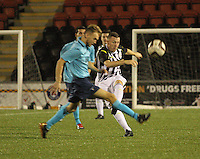 Declan Hughes clears ahead of the advancing Scott Mercer in the St Mirren v Dunfermline Athletic Scottish Professional Football League Under 20 match played at the Excelsior Stadium, Airdrie on 11.12.13.