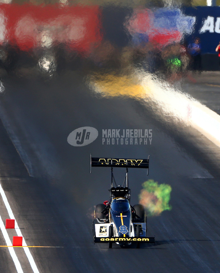 Feb 26, 2016; Chandler, AZ, USA; NHRA top fuel driver Tony Schumacher during qualifying for the Carquest Nationals at Wild Horse Pass Motorsports Park. Mandatory Credit: Mark J. Rebilas-