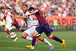 Rayo Vallecano´s Morcillo (L) and Barcelona´s Leo Messi during La Liga match between Rayo Vallecano and Barcelona at Vallecas stadium in Madrid, Spain. October 04, 2014. (ALTERPHOTOS/Victor Blanco)