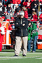 26 November 2010: Colorado Interium Head Coach Brian Cabral watching pre-game warm-ups before playing the Nebraska Cornhuskers at Memorial Stadium in Lincoln, Nebraska. Nebraska defeated Colorado 45 to 17.
