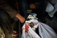 Khan Younes, Gaza Strip, Jan 12 2009.Naser Hospital, the bodies of 2 civilian casualties are being released from the morgue and given back to the families for burials. more than 392 cases have been treated in this small hospital since the beginning of the Israeli operation, mostly civilians. On the 16th day of the Israeli operation in Gaza, one and a half million people are still deprived of electricity and basic supplies, as well as being unable to flee from the densely populated combat zone.