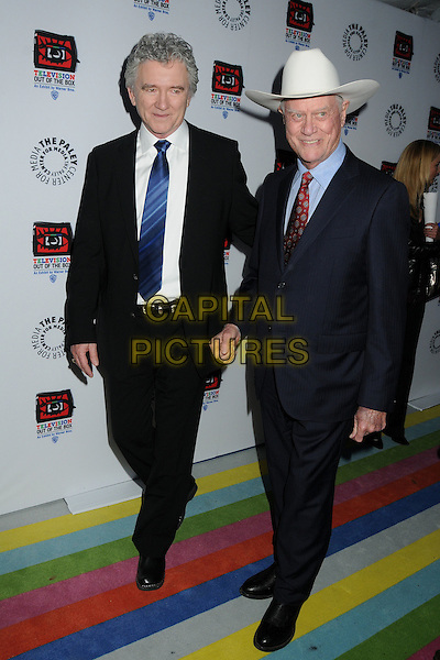 "Patrick Duffy, Larry Hagman.""Television: Out Of The Box"" Museum Exhibit created by Warner Bros. Television Group held at The Paley Center, Beverly Hills, California, USA..April 12th, 2012.full length black suit white stetson hat.CAP/ADM/BP.©Byron Purvis/AdMedia/Capital Pictures."