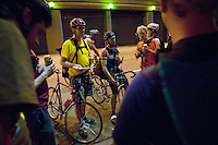 3 July 2005 - New York City, NY, USA - Riders share beers and jokes at an alleycat checkpoint on 43rd street in New York City, USA, July 3rd 2005. Alleycats are urban cycle races held informally - without notification of the authorities - on open roads and in real traffic, to simulate the messenger's working conditions. Photo Credit: David Brabyn<br />