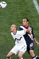 Miso Brecko (L) of Slovenia and Landon Donovan (R) of USA