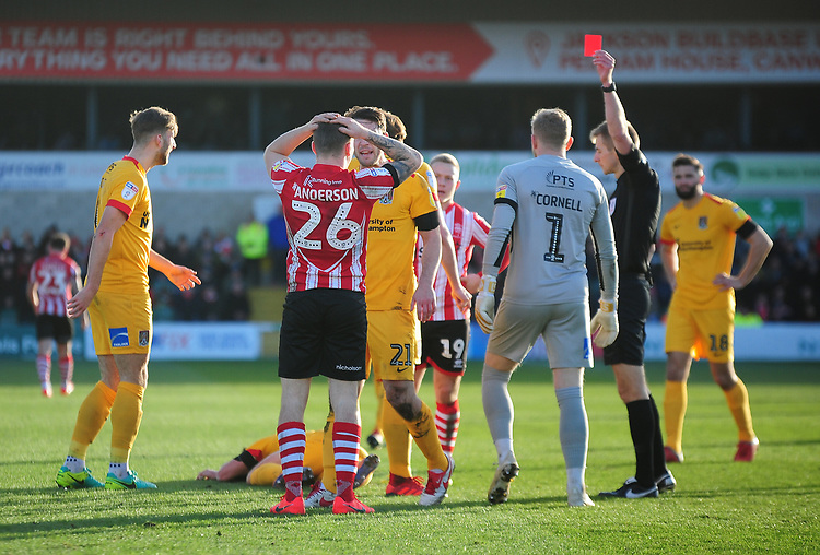 Lincoln City's Harry Anderson is shown a red card by referee Michael Salisbury<br /> <br /> Photographer Andrew Vaughan/CameraSport<br /> <br /> The EFL Sky Bet League Two - Lincoln City v Northampton Town - Saturday 9th February 2019 - Sincil Bank - Lincoln<br /> <br /> World Copyright &copy; 2019 CameraSport. All rights reserved. 43 Linden Ave. Countesthorpe. Leicester. England. LE8 5PG - Tel: +44 (0) 116 277 4147 - admin@camerasport.com - www.camerasport.com