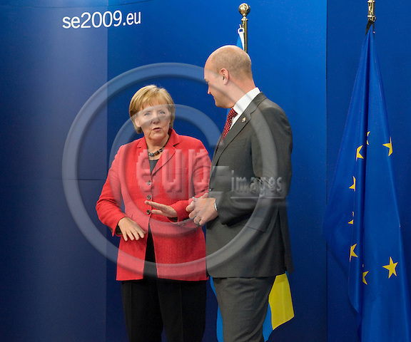 Brussels-Belgium - September 17, 2009 -- Informal European Council, EU-summit under Swedish Presidency; here, Fredrik REINFELDT (ri), Prime Minister of Sweden,  welcomes Angela MERKEL (le), Federal Chancellor of Germany -- Photo: Horst Wagner / eup-images