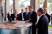 Guadalajara, Mexico - August 10, 2009 -- United States President Barack Obama, Canada's Prime Minister Stephen Harper, left,  Mexico's President Felipe Calderon, right, are shown a display on the making of tequila at the Cabanas Cultural Center in Guadalajara, Mexico, August 10, 2009. The three leaders were in Guadalajara for the North American Leaders' Summit.  .Mandatory Credit: Pete Souza - White House via CNP