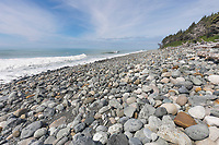 Rocky beach in the Gulf of Alaska, Pacific ocean coast, Glacier Bay National Park, Southeast, Alaska.