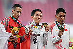 (L-R) Elhassan Elabbassi (BRN),  Hiroto Inoue (JPN), Duo Bujie (CHN), <br /> AUGUST 25, 2018 - Athletics - Marathon : Men's Marathon Victory ceremonyat Gelora Bung Karno Main Stadium during the 2018 Jakarta Palembang Asian Games in Jakarta, Indonesia. <br /> (Photo by MATSUO.K/AFLO SPORT)