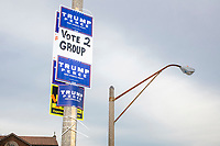 Signs for US President Donald Trump are seen outside the Holy Name Parish Hall polling place as people arrive to vote in the Massachusetts presidential primary on Super Tuesday in West Roxbury, Massachusetts, on Tue., March 3, 2020. The sign's references to Group 2 are in support of a pro-Trump slate of candidates in the Ward 20 local election.