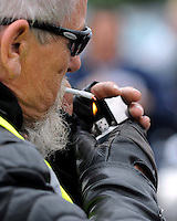 A Harley Davidson biker lights up his tobacco with his synonymous Zippo lighter at Ireland Bikefest at the weekend.<br /> Picture by Don MacMonagle