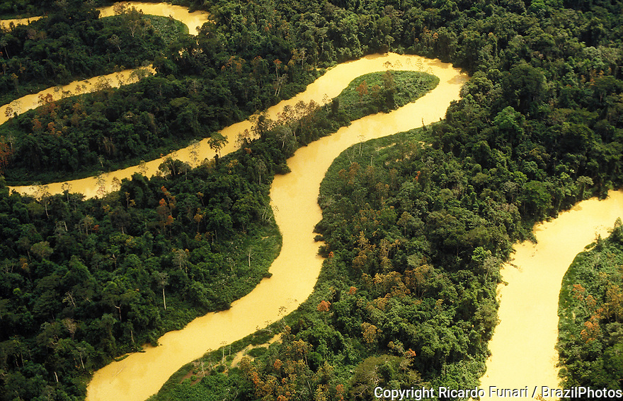 Aerial view of Amazon rain forest, river curves and dense forest with high biodiversity, Brazil.